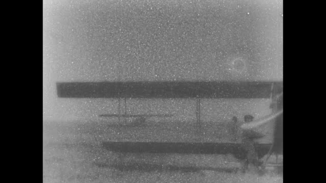 plane landing parked plane in foreground / group of pilots talking to captain w a robertson head of government aviation school / note exact month/day... - inglewood stock videos and b-roll footage