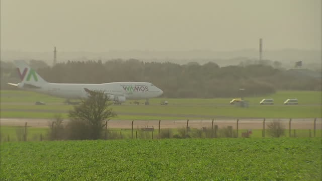plane lands carrying 32 passengers from quarantined cruise ship shows plane landing and taxiing at airfield coaches leaving airfield interiors of... - cruise stock videos & royalty-free footage
