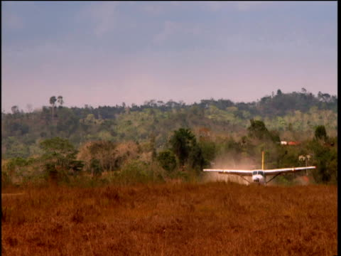 plane lands in barren field as dust billows from ground nicaragua - nicaragua stock videos & royalty-free footage