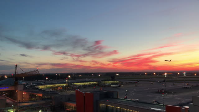 Plane lifts off at Sheremetyevo Moscow Airport during sunset