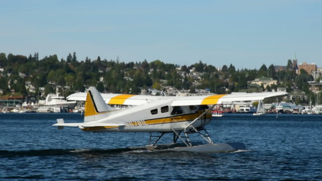 plane off seattle south lake union - seattle stock videos & royalty-free footage