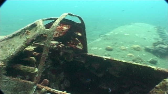 wwii plane on sea floor, move into cockpit.  kimbe bay, west new britain, png - papua stock videos and b-roll footage