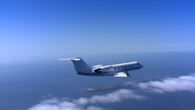 plane over clouds and ocean - artbeats stock videos & royalty-free footage