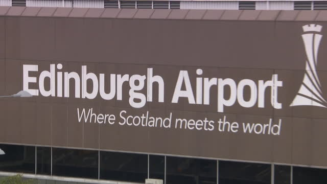 plane taking off from edinburgh airport - moving up stock videos & royalty-free footage
