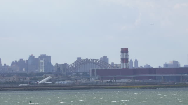 plane taking off from laguardia airport in new york city. - air traffic control stock videos & royalty-free footage