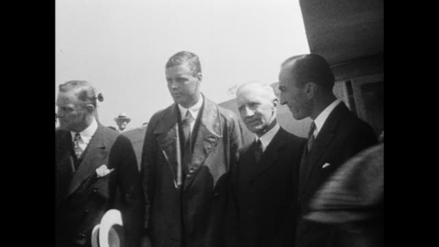 Plane taxiing Lindbergh after landing at Ford aiport in Dearborn Michigan Lindbergh is greeted by Henry Ford