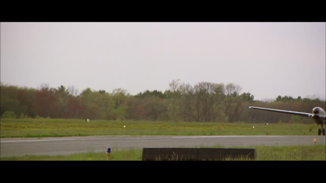 ms plane taxiing on runway - taxiing stock videos & royalty-free footage