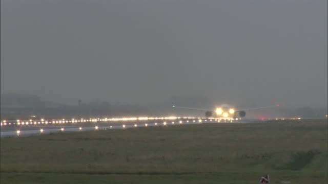 a plane taxis on the heathrow airport runway in london. - airport stock videos & royalty-free footage