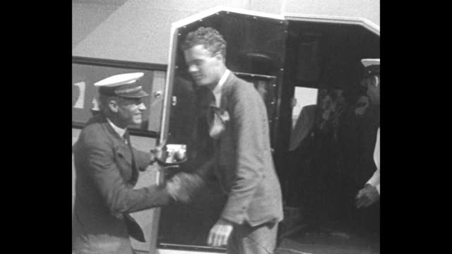 plane that charles lindbergh has flown to camaguey sitting on airfield crowd next to it / lindbergh getting out of plane and being greeted by... - charles lindbergh stock videos & royalty-free footage
