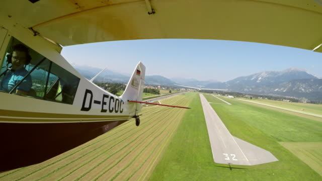 ld plane towing a glider into the air in sunshine - mezzo di trasporto aereo video stock e b–roll