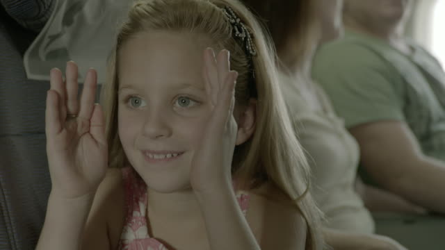 plane travel family holiday pretty blond girl pretending to look out of the window of a plane her parents are sitting next to her - chroma key stock videos & royalty-free footage