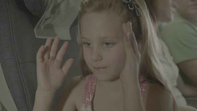 plane travel family holiday pretty blond girl pretending to look out of the window of a plane as it is taxies on the runway - chroma key stock videos & royalty-free footage