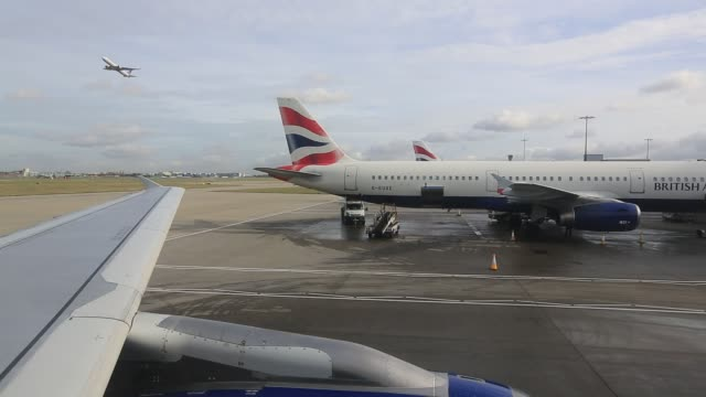 planes at heathrow airport london uk - travel stock videos & royalty-free footage