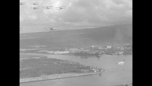 stockvideo's en b-roll-footage met planes flying over water seen from air / closer shot planes over water land below / aerial planes with harbor below smoke from ship smokestack /... - long beach californië