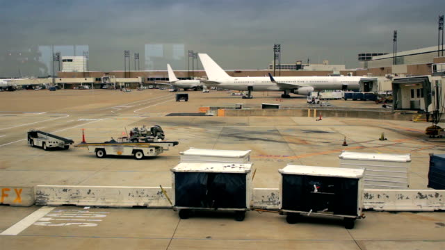 Planes parked at airport gates.
