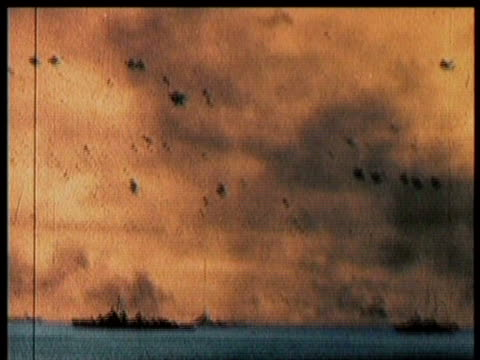 vídeos de stock, filmes e b-roll de planes take off from aircraft carrier / raging battle in sea and sky / sinking of uss princeton / plane lands in distress on carrier / narrated - guerra do pacífico