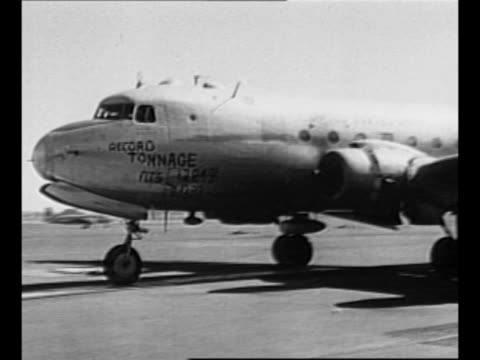 us c54 planes taxi in opposite directions on airfield / us c54 taxis on runway with paintedon message claiming record tonnage delivered in airlift /... - 1948 stock videos & royalty-free footage