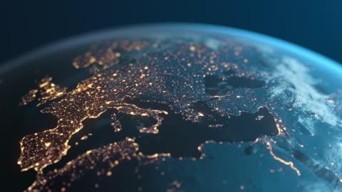 stockvideo's en b-roll-footage met planet earth at night - europa gezien vanuit de ruimte - economie