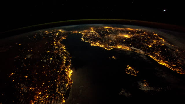 vidéos et rushes de planet earth at night from the international space station (iss): over the mediterranean - land