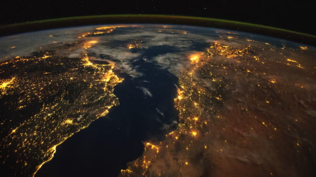 Planet Earth at night from the International Space Station (ISS). Time lapse of the rotation and city lights. Space exploration