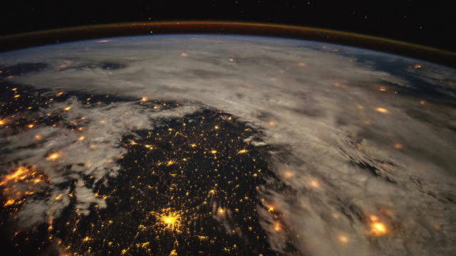 planet earth at night from the international space station (iss). time lapse of the rotation and city lights. space exploration - 太陽系点の映像素材/bロール