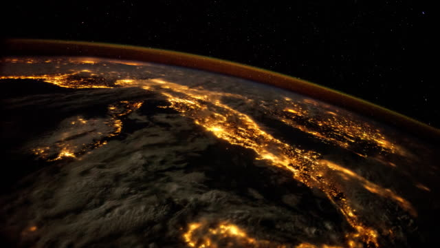 planet earth at night seen from the iss: lights of europe  (italy clearly seen in clip) - space and astronomy stock videos and b-roll footage