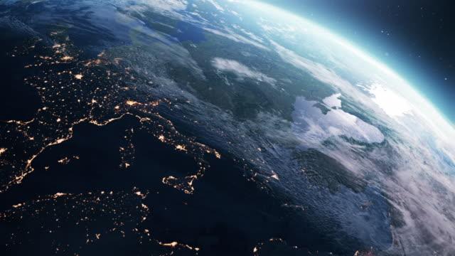 vídeos y material grabado en eventos de stock de planeta tierra. día a noche. orbitando sobre el sur de europa - espacio en blanco