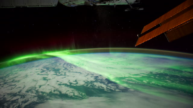 planet earth from iss or international space station: aurora australis over the indian ocean with elements of spatial ship in the image - aurora australis stock videos & royalty-free footage