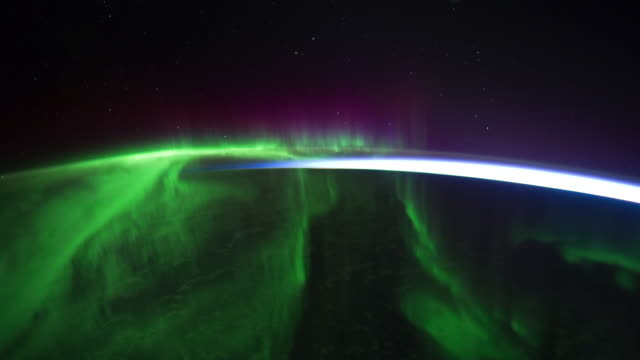 planet earth from iss or international space station: spectacular aurora australis - aurora australis stock videos & royalty-free footage