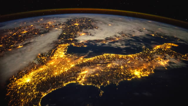 planet earth from space. aerial view of the city lights on a clear night. - terreno video stock e b–roll