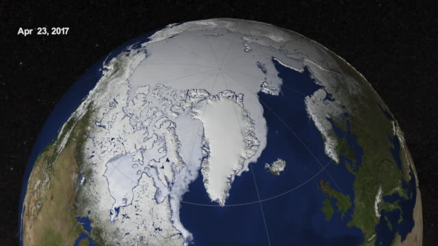 planet earth from space: arctic sea ice from march to september 2017 - climate change stock videos & royalty-free footage