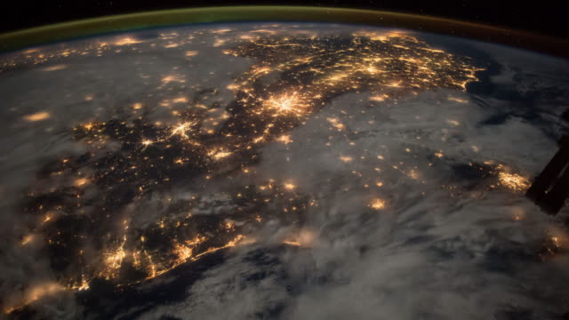 vídeos de stock e filmes b-roll de planet earth from space at night, point of view from the international space station (iss) - exploração espacial