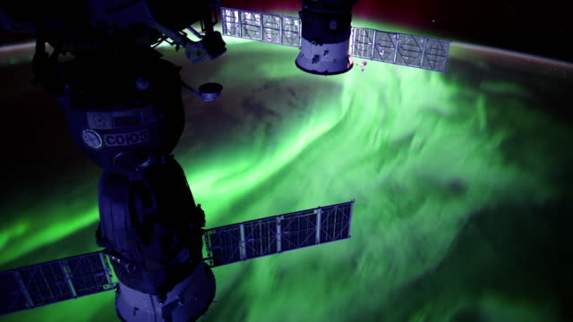 planet earth from space: aurora borealis one of the most awesome events in nature - form stock videos and b-roll footage