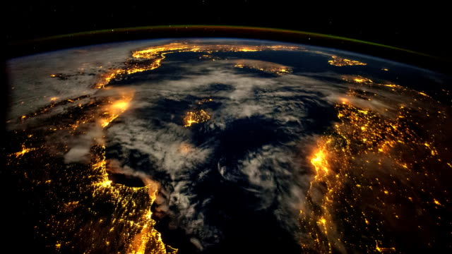 planet earth from the international space station: nighttime view of lights - terreno video stock e b–roll
