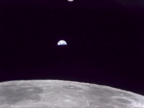 planet earth is seen from the moon. apollo 11 was the first space flight landing humans in the moon. neil armstrong and buzz aldrin walked about two... - atmosphere filter stock videos & royalty-free footage
