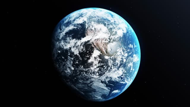 planet earth is spinning in outer space against black background with stars - globe stock videos & royalty-free footage