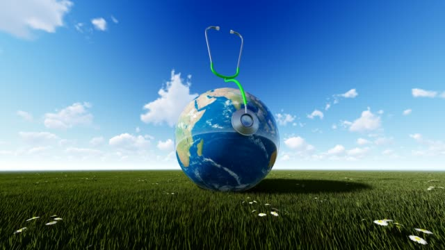 Planet Earth On Grass With Cloudly Sky For World Health Day