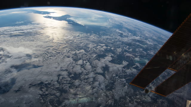 planet earth or blue planet beautiful view from the iss (international space station). creative flare by the end of image - low stock videos and b-roll footage
