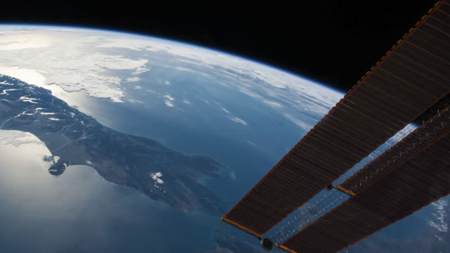 planet earth or blue planet beautiful view from the iss (international space station). ease out as flying over new zeland - new zealand stock videos & royalty-free footage
