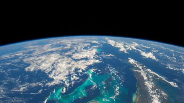 vídeos de stock, filmes e b-roll de planet earth or blue planet beautiful view from the iss (international space station). - espaço e astronomia