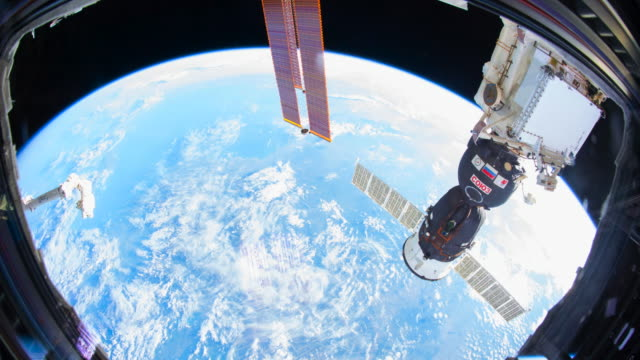 planet earth point of view from the interior of the iss (international space station). space exploration of our home blue planet - spazio cosmico video stock e b–roll