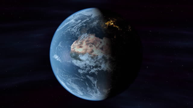 planet earth rotates from day into night. - planet earth stock videos and b-roll footage