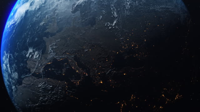vídeos de stock, filmes e b-roll de planet earth rotates in space from day into night and city lights turn on. - espaço e astronomia