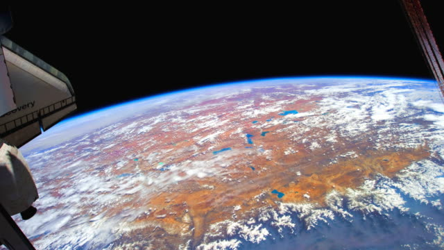planet earth seen from outer space while the space shuttle discovery is docked to the iss - space shuttle discovery stock videos & royalty-free footage