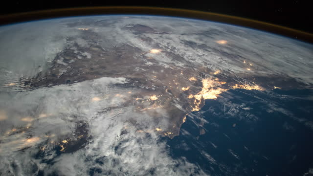 planet earth seen from space. real video. no cgi. taken from international space station - spazio cosmico video stock e b–roll