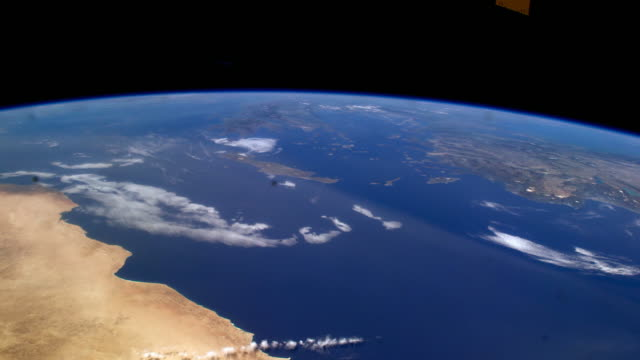 planet earth seen from space. the international space station explores every corner of our beautiful blue planet - 30秒以上点の映像素材/bロール