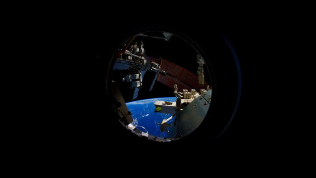 planet earth view from space: rotation seen through small ship cupola - vehicle interior stock videos & royalty-free footage