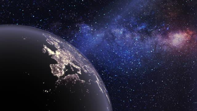 planet erde mit nachtlichtern in einem fantasy-nebel-weltraumuniversum - rätsel stock-videos und b-roll-filmmaterial
