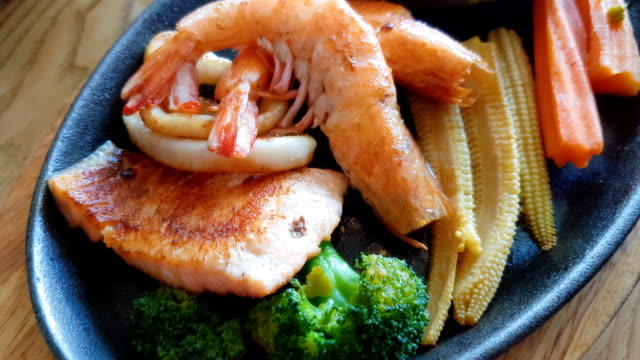 planning close up of delicious grilled seafood platter - scampi seafood stock videos and b-roll footage
