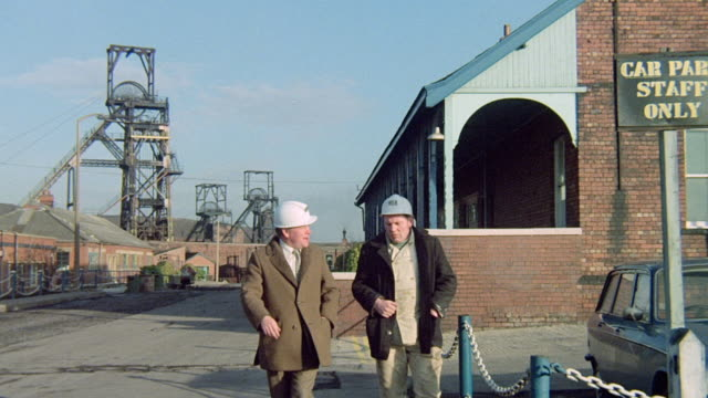 montage planning engineers walking among collieries and colliery plants on the horizon / pontefract, england, united kingdom - prince of wales stock videos & royalty-free footage